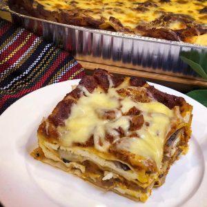 Slice of lasagna on white plate